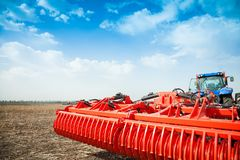 Modern tractor in the field with complex for the plowing of soil. Royalty Free Stock Images