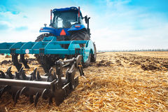 Modern tractor in the field on a sunny day. Stock Image