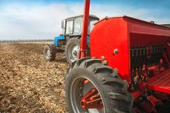 Modern tractor with sowing complex on the field. Royalty Free Stock Photography