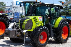 Modern tractors and harvester on display on Agricultural fair. Novi Sad, Serbia: may 9. 2015 - Novi Sad Agro fair with people and Fair show. Modern tractors and Royalty Free Stock Photos