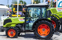 Modern tractors and harvester on display on Agricultural fair. Novi Sad, Serbia: may 9. 2015 - Novi Sad Agro fair with people and Fair show. Modern tractors and Royalty Free Stock Photography