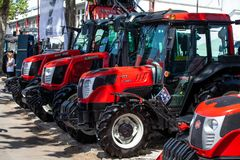 Modern tractors and harvester on display on Agricultural fair. Novi Sad, Serbia: may 9. 2015 - Novi Sad Agro fair with people and Fair show. Modern tractors and Royalty Free Stock Image