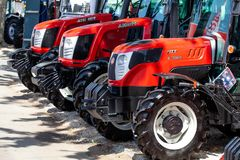 Modern tractors and harvester on display on Agricultural fair. Novi Sad, Serbia: may 9. 2015 - Novi Sad Agro fair with people and Fair show. Modern tractors and Royalty Free Stock Photo