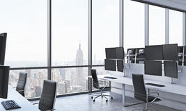A modern trader's workplaces in a bright modern open space office. White tables equipped with modern trader's stations and black c Royalty Free Stock Photos