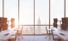 A modern trader's workplaces in a modern panoramic office in New York city. A concept of financial market culture. A sunset. 3D re. Ndering. Toned image Stock Photography