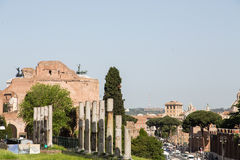 Modern Traffic by Anceint Ruins in Rome Stock Images