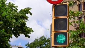 Modern traffic LED light blinking and changing color from green to yellow and finally red stock footage