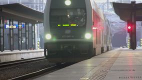 Modern train arriving at railway station, transportation services industry. Stock footage stock video