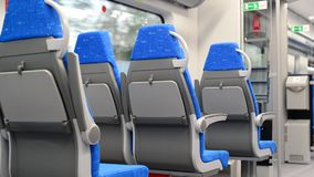 Modern train with blue seats in motion. Modern train with blue seats in a motion stock video footage
