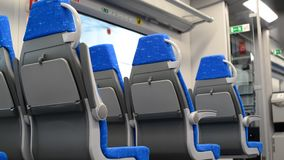 Modern train with blue seats in motion stock footage