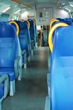 Modern train and blue seats Royalty Free Stock Images