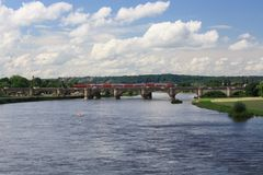Modern train on a bridge in Dresden, Germany. River in Dresden, beautiful landscape Royalty Free Stock Images