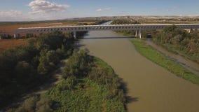 Modern train bridge over ebro river stock video