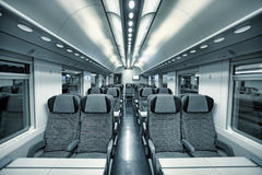 Modern train coach interior view. Royalty Free Stock Photos