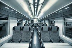 Modern train coach interior view. Royalty Free Stock Photos