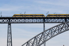 Modern train crossing a modern bridge Stock Photo