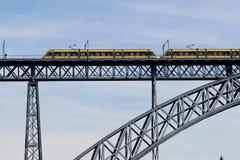 Modern train crossing a modern bridge. Modern train crossing a beautiful steel bridge Stock Photo