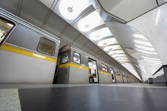Modern train on metro station with opened doors. Modern grey train on metro station with opened doors, granite floor, big lamps royalty free stock photos