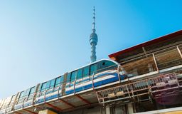 The modern train of Moscow Monorail. Line at the Teletsentr station with a view on Ostankino Tower on the background, Russia royalty free stock images