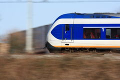 Modern train in motion. A modern Dutch train moving past Royalty Free Stock Images