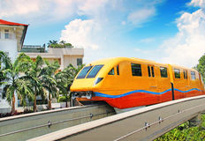 Modern train in motion. Modern yellow train in motion Royalty Free Stock Photography