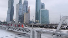 Modern train near Moscow city Russian skyscrapers. Lastochka second metro ring. Subway intersection. Highway. Winter day Station. Unique aerial drone 4K footage stock video footage