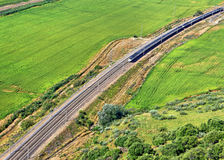 Modern train passing through country landscape Stock Photography