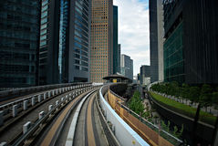 Modern train station in between buildings at the city. Yokyo, Ja Stock Photos