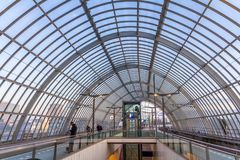 Modern train station with curved glass roof Royalty Free Stock Photo