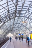 Modern train station with curved glass roof Stock Images