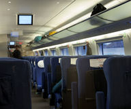 Modern train at the station. Empty interior of a passenger train car . Public transport Royalty Free Stock Photo