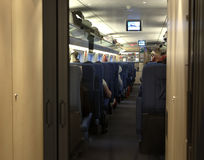 Modern train at the station. Empty interior of a passenger train car . Public transport Royalty Free Stock Photos