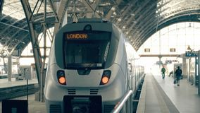 Modern train to London. Travelling to the United Kingdom conceptual intro clip. Modern train to London. Travelling to the United Kingdom conceptual intro stock footage