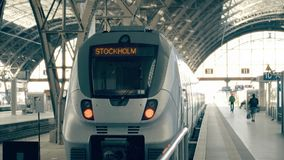Modern train to Stockholm. Travelling to Sweden conceptual intro clip. Modern train to Stockholm. Travelling to Sweden conceptual intro stock footage