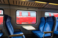 Modern Train Wagon Interior Seats Rows Blue Transportation White. Daytime Traveling Empty Stock Image