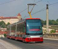 Modern tram. Modern fast tram in the urban landscape Stock Photos