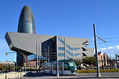 Modern tram in Barcelona near Agbar Tower, Spain Stock Images