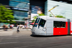 Modern tram blurred in motion in the Prague city Stock Photo