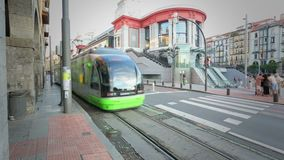 Modern tram car riding along Bilbao streets, public transportation in Europe. Stock footage stock footage