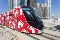 Modern tram in Dubai Marina. DUBAI, UAE - DEC 5, 2016: Modern trolley car at the new tram service in the city of Dubai. United Arab Emirates, Middle East Stock Photography