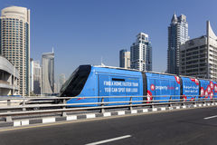 Modern tram in Dubai Marina. DUBAI, UAE - DEC 5, 2016: Modern trolley car at the new tram service in the city of Dubai. United Arab Emirates, Middle East Royalty Free Stock Images