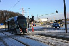 Modern tram in Luxembourg Ville. Photo made in the winter, in the cold day, snow on the street Royalty Free Stock Photo
