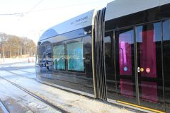 Modern tram in Luxembourg Ville. Photo made in the winter, in the cold day, snow on the street Stock Photography