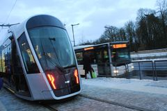 Modern tram in Luxembourg Ville. Photo made in the winter, in the cold day, snow on the street Royalty Free Stock Image