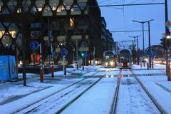 Modern tram in Luxembourg Ville. Photo made in the winter, in the cold day, snow on the street Stock Image