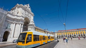 Modern tram pass at Praca do Comercio and Augusta Street Arch, Lisbon stock video footage