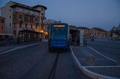 Modern tram rides through the central square in Padua royalty free stock images