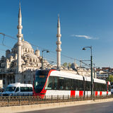A modern tram rides over the Galata Bridge in Istanbul, Turkey Royalty Free Stock Photography
