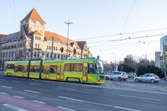 The modern tram Solaris Tramino rides down central street in the Poznan. Poland. Poznan, Poland - December 05, 2018: The modern tram Solaris Tramino rides down royalty free stock image