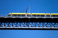 Modern tram on a steel bridge Stock Images